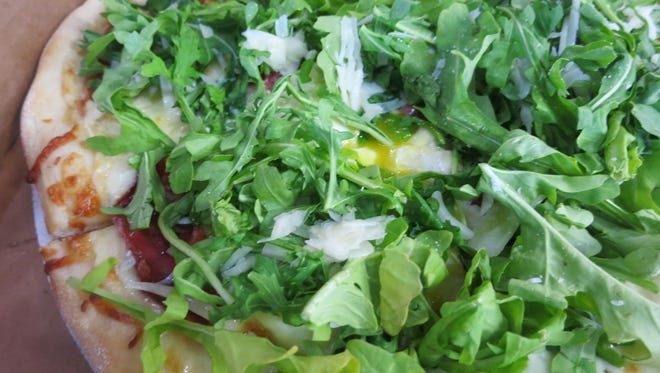 The Ham and Greens pizza at Annabel Cohen Cooks Detroit pizza shop is topped with arugula and Pecorino Romano cheese.