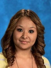 Lucia Guadalupe Pamatz poses for a school photo at