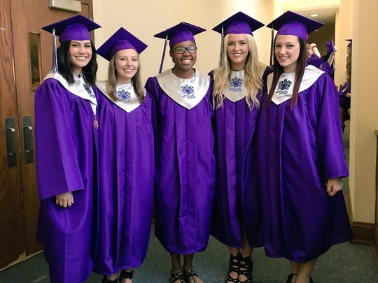 University Academy of Central Louisiana graduates Casie Guillory, Demi Adams, Hannah Glaze and Rowan McConville are ready for commencement Monday at Guinn Auditorium on the Louisiana College campus in Pineville.