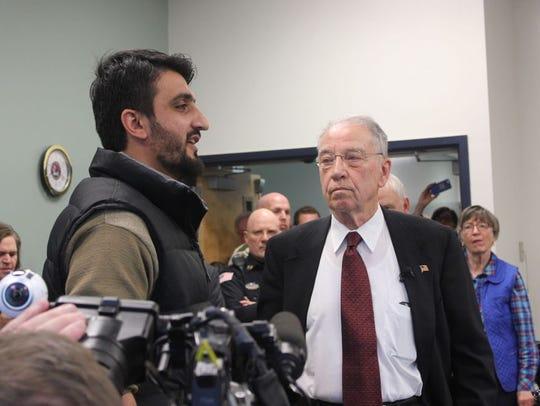 Sen. Chuck Grassley, right, talks with Zalmay Niazy