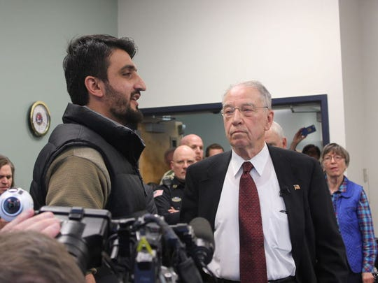 "Sen. Chuck Grassley, right, talks with Zalmay Niazy of Iowa Falls, Iowa, an Afghan man who said he was shot twice while serving as an interpreter for U.S. military in his country. Niazy said his application for political asylum in the United States has been stalled for two years. ""I am a Muslim. Who is going to save me here?"" he asked."
