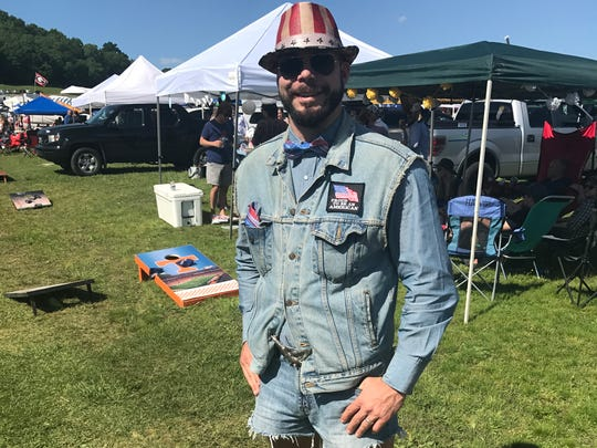 Thomas Bauer rocks an American flag themed hat to pair with his all-denim look at the 76th annual Iroquois Steeplechase Saturday, May 13, 2017.