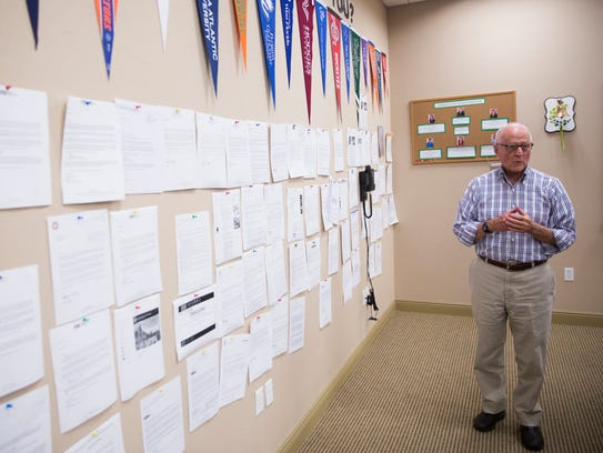 Dick Munro walks looks at the college acceptance letters