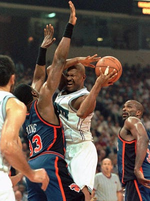 Charlotte Hornets guard Ricky Pierce runs into New York Knicks center Patrick Ewing in 1997. Pierce was drafted No. 18 in the 1982 NBA draft by the Pistons.