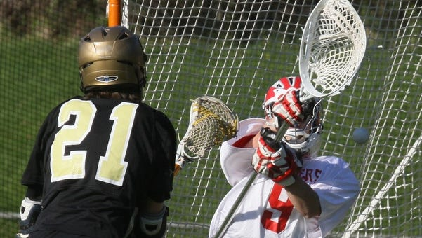 TJ Dertinger of Nanuet scores on North Rockland goalie Michella during their game at North Rockland April 14, 2010. Nanuet won 9-4. ( Peter Carr / The Journal News )