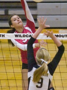 Canton's Courtney Kurkie (left) signed to play college volleyball at Michigan Tech.