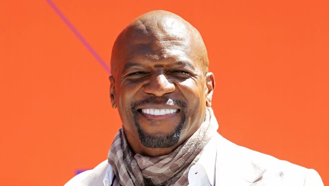 Entertainer, artist and former NFL pro player Terry Crews turns the big 50 on July 30, 2018!  Born in Flint, Mich., he earned an Art Excellence scholarship from Western Michigan University and athletic scholarship to play football.  Crews is all smiles at the 2018 BET Awards in Los Angeles, Calif.