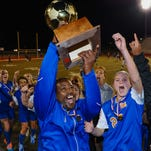 Madison Central coaches and players celebrate with the trophy following the Lady Jags 1-0 win over Brandon in the  the MHSAA Soccer State 6A Championship held in Clinton Saturday February 6th 2016.