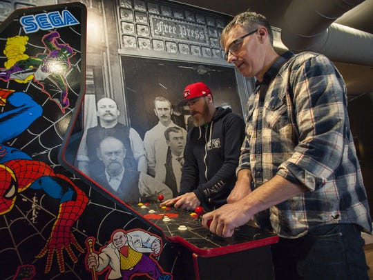 The Archives arcade bar co-owner Matt Walters, right,