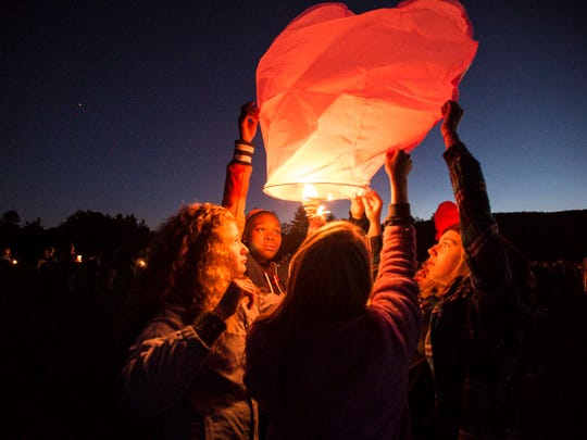 Students send heart-shaped lanterns aloft during a vigil for five high school students killed in a head-on crash on I-89 held at Harwood Union Middle/High School in Duxbury on Monday, October 10, 2016.