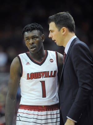 Louisville interim head coach David Padgett (right) talks with Lance Thomas (1) as the Cardinals take on Kentucky Wesleyan on Monday at the KFC Yum! Center. Louisville won 101-64. Oct. 30, 2017