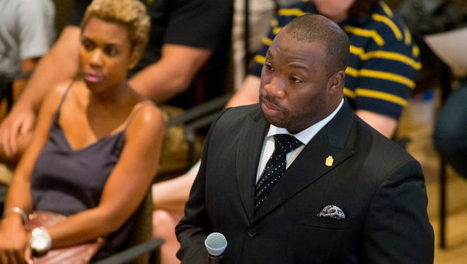 Roy Tatem, president of Alpha Phi Alpha Phoenix chapter, reads a question Sunday (Aug. 24, 2014) from the audience during the Phoenix Bridging Gaps Between Community and Police Town Hall at Steele Indian School Park Memorial Hall.