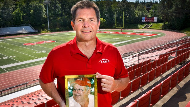 St. John's University Head Football Coach Gary Fasching starts a new season without his dad, Joseph, who died several weeks ago. Coach Fasching added that Joseph used to come to all his home games. Fasching was photographed Aug. 10, 2016, at Clemens Stadium.