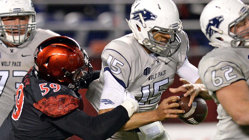 Wolf Pack quarterback Tyler Stewart has the ball jarred