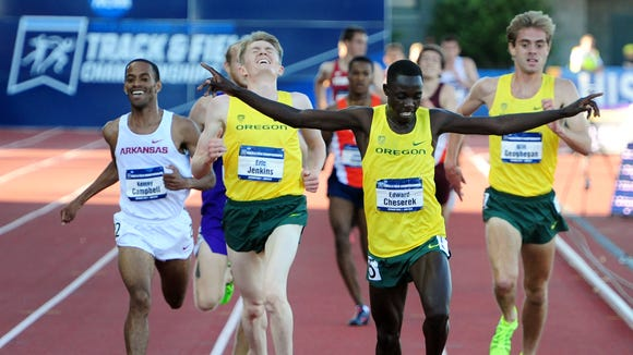 Oregon's Edward Cheserek beats teammates Eric Jenkins, left, and Will Geoghegan in the 5000 meter run following during the NCAA Men's Division I 2015 Outdoor Track & Field Championships at Hayward Field, on Friday, June 12, 2015, in Eugne, Ore.