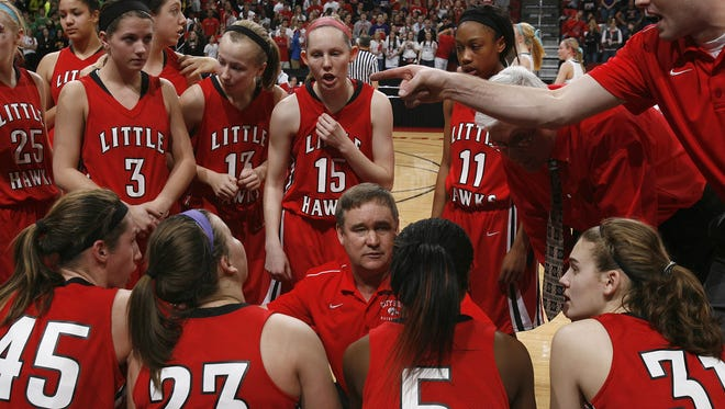 Iowa City High girls coach Bill McTaggart talks to his players during a time-out in Wednesday's game against Iowa City West at Wells Fargo Arena in Des Moines. (Bryon Houlgrave/The Register)