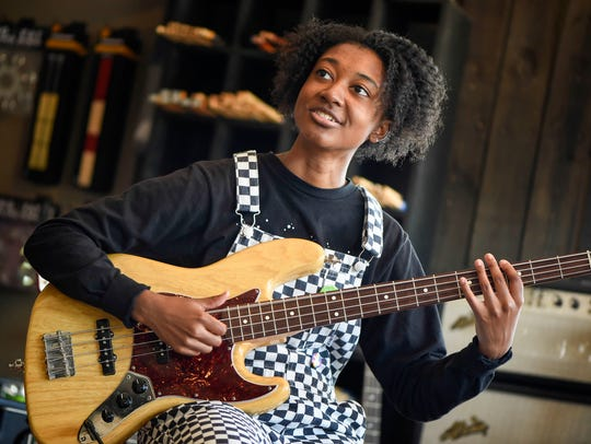 Guitarist Melanie Faye checks out basses and guitars at Eastside Music Supply in Nashville, Tenn., Tuesday, May 8, 2018.