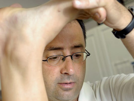 Larry Nassar shown treating a patient in 2008.