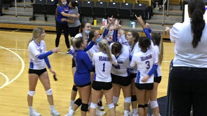 Seaman's volleyball team celebrates its three-set victory over Washburn Rural on Tuesday night at Topeka High.
