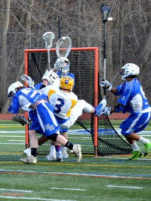 Mahopac midfielder Dan Foley (3) is stopped on the doorstep, but the Indians pulled away late Thursday for a 12-9 win over Hen Hud.