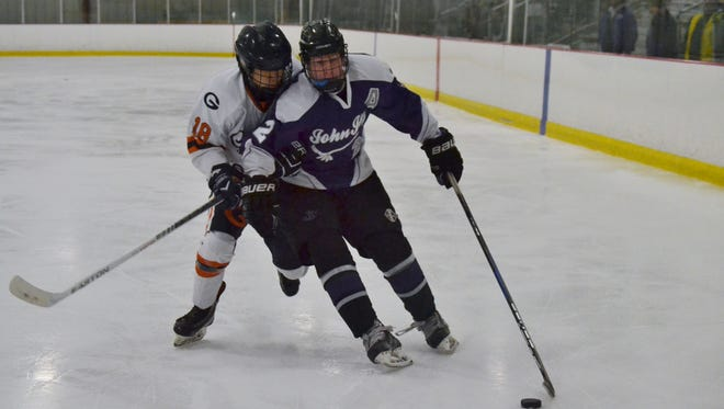 Sean Blaney carries the puck in for John Jay during a 6-3 win over Greeley on Saturday at BIA.