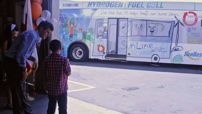 Two local students' artwork will be showcased on SunLine Transit Agency buses throughout the valley for the next year as part of SunLine's annual student art contest. The winning designs, unveiled Wednesday at the Renova Solar offices in Palm Desert, were submitted by second grader Robert Campos and fifth grader Lianna Reyes.