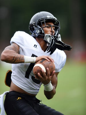 Southern Miss wide receiver Allenzae Staggers catches the ball during a drill at the fall football camp on Wednesday.