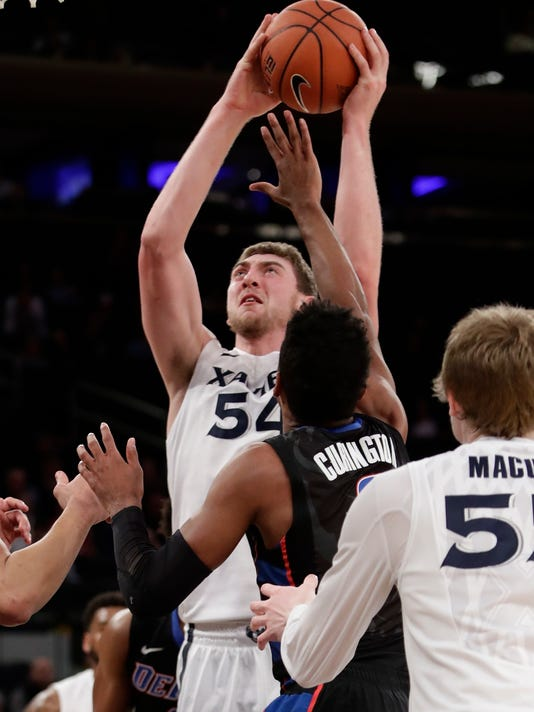 Xavier's Sean O'Mara (54) shoots over DePaul's R.J. Curington (0) during the first half of an NCAA college basketball game in the Big East men's tournament Wednesday, March 8, 2017, in New York. (AP Photo/Frank Franklin II)