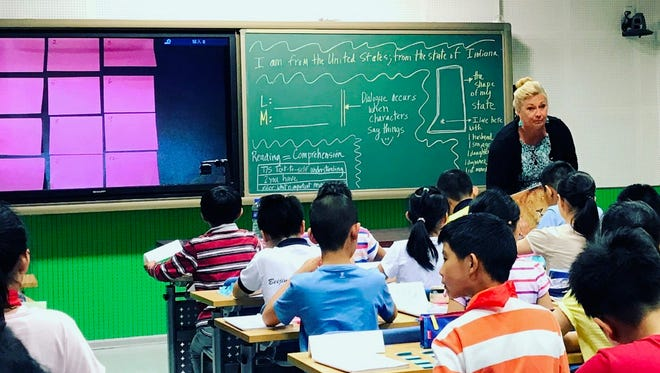 Melissa McNabb teaches during her research trip to Beijing, China.