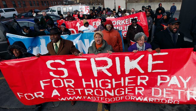 Demonstrators rally for higher wages in Detroit on Dec. 5.