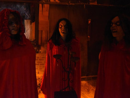 A trio of vampires greet guests early in the tour of