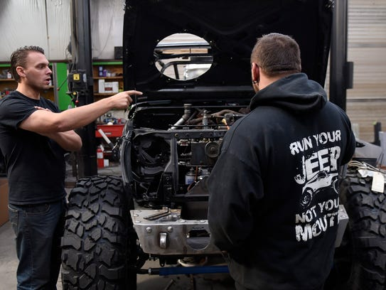 A production crew films Kenny Hauk, left, and Rick
