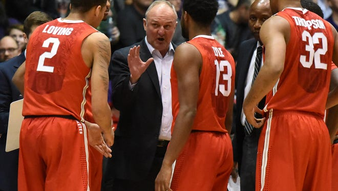 Ohio State Buckeyes head coach Thad Matta (C) huddles with his team during a timeout against the Northwestern Wildcats during the first half at Welsh-Ryan Arena on Jan. 6.