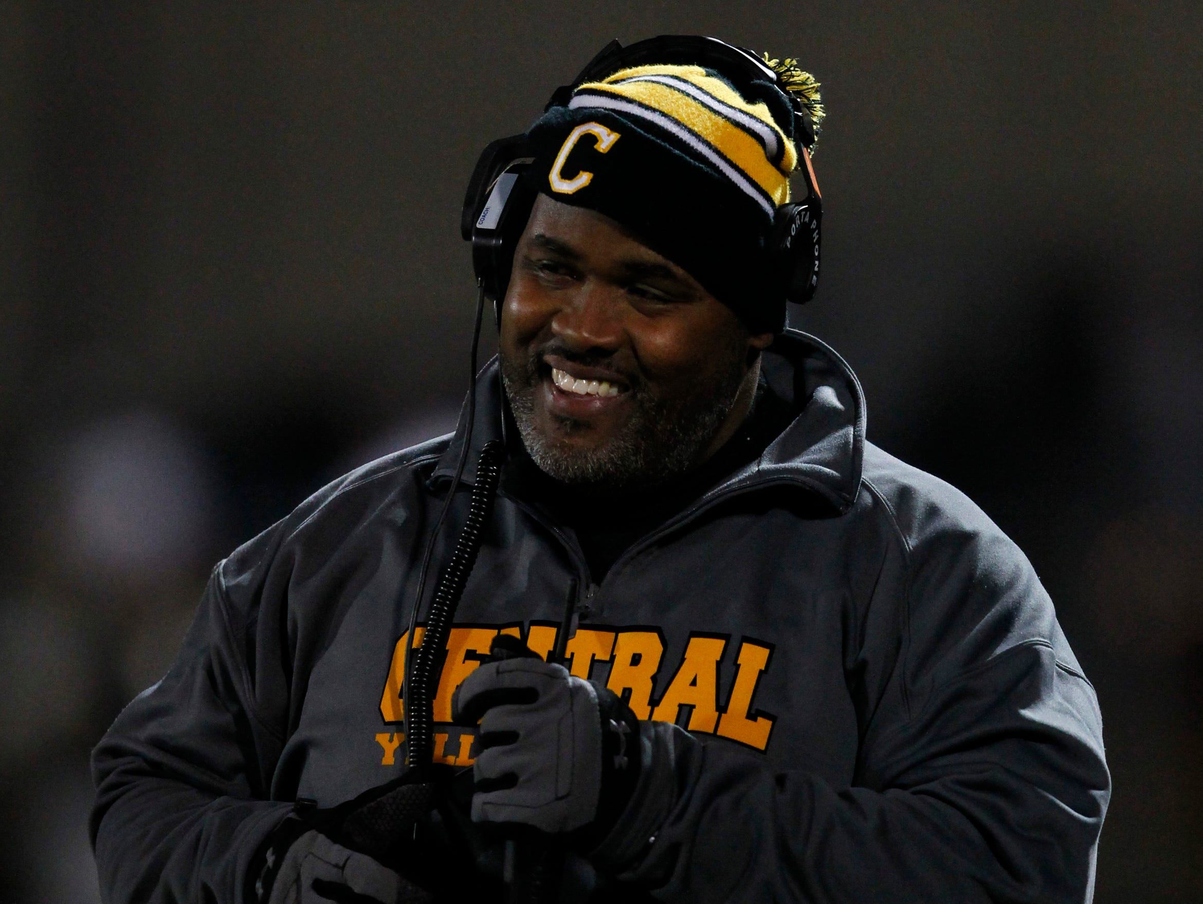 Central High School head coach Tyrran Scroggins reacts to his team play against South Warren High School during the first half of play at Central High School in Louisville, Kentucky. November 28, 2014