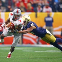 Ohio State Buckeyes wide receiver Michael Thomas (3) is tackled by diving Notre Dame Fighting Irish cornerback Nick Watkins in the second half during the 2016 Fiesta Bowl at University of Phoenix Stadium.