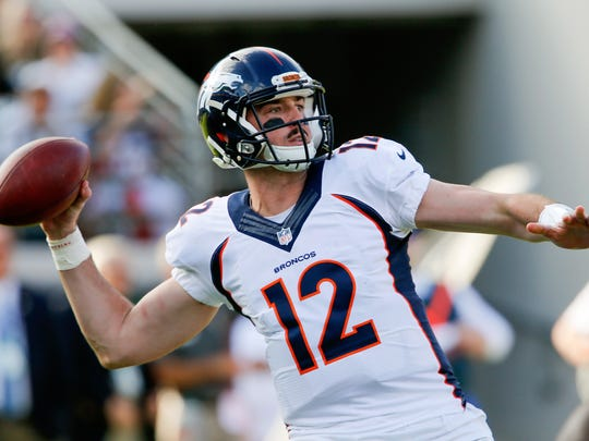 Denver Broncos quarterback Paxton Lynch (12) throws