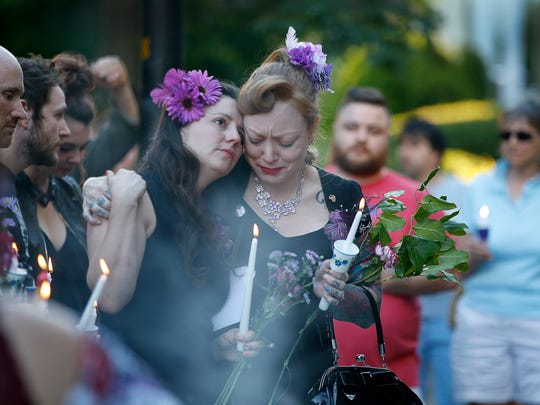 Rebecca Newberry and Erica Bochetto get emotional during the vigil for their friend Kelly O'May, who was stabbed to death in her apartment on Caroline Street in June 2018.