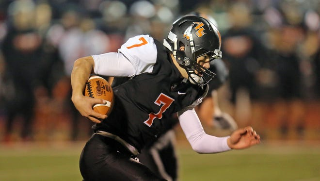 Anderson quarterback Jay Volpenhein runs for a touchdown in the first quarter in the playoff game between the Troy Trojans and the Anderson Redskins at Anderson High School, November 3, 2017.