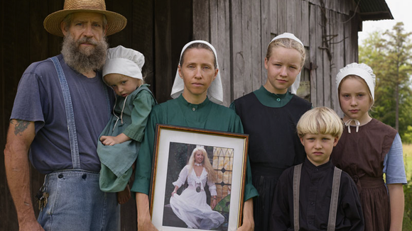 """Lucas Foglia, """"Family Portrait with the Photograph George Took of Christina Before They Were Married, Tennessee,"""" 2008."""
