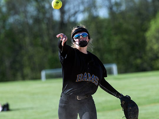 Kennard-Dale's third baseman Megan Greeny throws to first, Wednesday, May 3, 2017. The Rams beat the Bolts, 9-3, clinching the YAIAA III championship.
