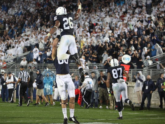 Saquon Barkley is lifted into the air after scoring a touchdown vs. Rutgers on Saturday night. Barkley has become the Nittany Lions' best offensive weapon this season.