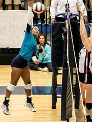 Siegel's Asha Phillips goes up for a kill.