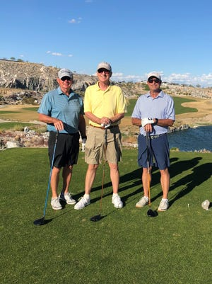 Terry Slingluff, Dave Hanson and  Carlos Lieser played the 18th hole at the Verrado Victory Course in March.