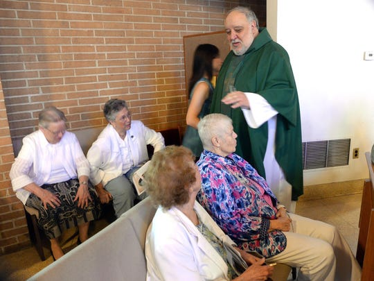 Father Saporito greets parishoners before his last mass as the pastor of Saint Padre Pio parish, Sunday, Jun. 28, 2015 in Vineland.