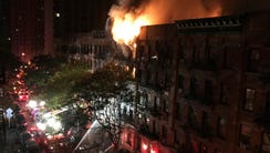 Firefighters work to put out a blaze at an apartment