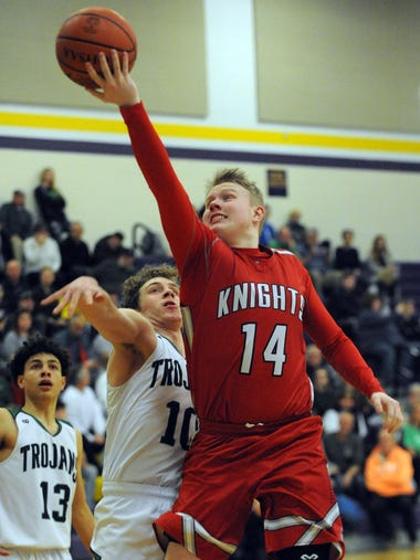 Fairfield Christian's Bradley Anderson goes in for