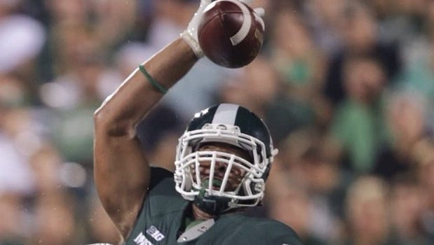 Michigan State linebacker Ed Davis gets his hand up to block a pass attempt by Western Michigan on Aug. 30, 2013.