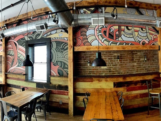 Details of Joe Pimemtel's mural are shown at Melzingah Tap House in Beacon.