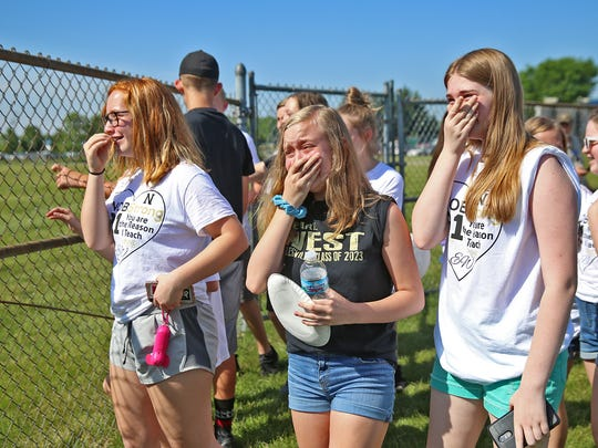 Students of Noblesville West Middle School science teacher Jason Seaman become emotional as they get ready to see him, over a fence, at the IHSAA baseball championships, the Noblesville vs Hamilton Southeastern game, Monday, May 28, 2018.  This is the first time the students have seen their teacher since Friday May 25's school shooting.  When a student opened fire in the seventh grade science classroom, Seaman intervened to stop the shooter from shooting more students.  He and one student were shot in the incident.  He was shot three times.  He told the students he couldn't hug them just yet, because he was still a little tender, but he could high five them.
