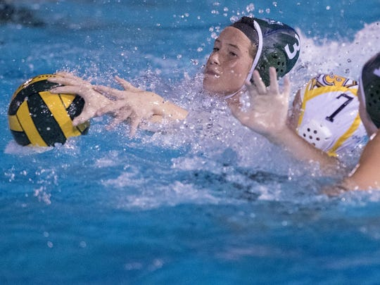 El Diamante's Makenzie Huskey, left, and Chelsea Battle battle with Golden West's Maison White in a Central Section Division II girls water polo semifinal on Wednesday.